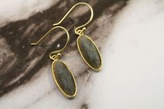 These Labradorite Oval Dangle Earrings are sterling silver with yellow gold plating #fashionista #jewelrytrends #dangleearrings #houma