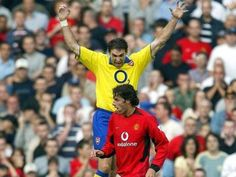 The battle of old Trafford .In Sept 2003 , Arsenal was playing Man U at Old Trafford when the game turned out to be the most ferocious game in history of EPL. In this pic Arsenal center back  Martin Keown is seen celebrating jumping over Van Nistelrooy when he missed the final penalty.