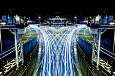 """With his project """"Graffiti of Speed / Mirror Symmetry"""", the Japanese photographer Shinichi Higashi offers beautiful images of Tokyo, by combining symmetry and l"""