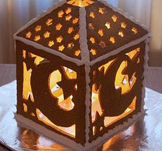 The December 2009 Daring Bakers' challenge was hosted by Anna of Very Small Anna and Y of Lemonpi. They chose to challenge us to bake and assemble a gingerbread house from scratch. They chose recip...