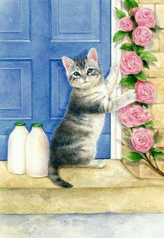 gattino con bottiglie di latte