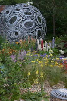 The Brewin Dolphin Garden, designed by Rosy Hardy, where the planting echoes the changing landscape from dried river bed to grasslands.