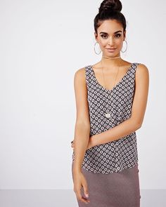 GO-TO'S<br />This lightweight printed cami blouse has a flowy, rounded hi-low hem and V-neckline at the front and back. This versatile top calls for a pencil skirt or skinny pants.<br /><br />- V-neckline at the front and at the back<br />- Wide straps<br />- Rounded hemline<br />- Lined