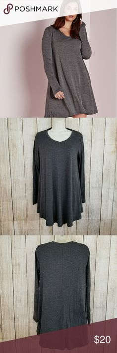 """Tunic top Comfy loose tunic top. Charcoal gray. 95% rayon, 5% spandex.  Very cute!   Measurements armpit to armpit 17"""" length 28"""" sleeve length 18"""" Dresses"""