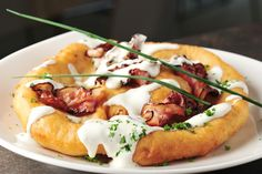 Lángos is the Hungarian name of a flat cake that today is deep-fried from a potato-based dough.