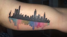 My firsts tattoo! What: New York City Skyline with a splash of color. When; 09/26/15 Where: NYC Ink