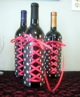 "Take coordinating paper, use a hole punch and ribbon and create ""corsets"" for the wine bottles!"