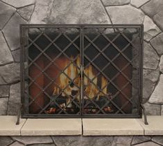 A stately focal point for the hearth, our Iron Weave Open Door Firescreen features a latticework design that fits in with both casual and formal settings. The two doors swing open for easy fire tending, and arched feet at the base provide stabilit… Fireplace Screens With Doors, Decorative Fireplace Screens, Fireplace Doors, Fireplace Set, Living Room With Fireplace, Fireplace Ideas, Wrought Iron Fireplace Screen, Fireplace Design, Mantle