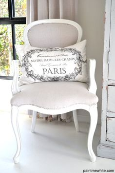 I love the tradition style of the chair with the simple white and tan tones. The Paris pillow is just the cherry. <3
