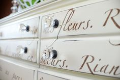 Royal Design Studio letters and French quotes/sayings stencils take distressed dresser from a furniture piece to a work of art. - via Living Rich on Less
