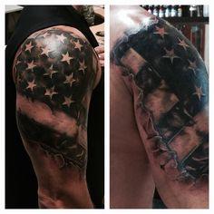 Ripped American flag tattoo