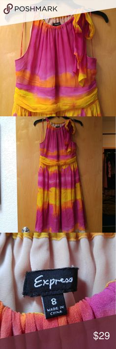 """FINAL PRICE Express Sunset Halter Dress Express, size 8 (medium), in excellent condition! This dress is so gorgeous and perfect for summer! Features a warm and colorful striped watercolor print in pink, orange, and yellow, halter top, side zip, full lining, and bow tie at left shoulder. Has a few very small, unnoticeable pulls. Measurements are 17.5"""" pit to pit and 36.5"""" length. Please ask any questions. No trades. Price firm. Thanks! Express Dresses Mini"""