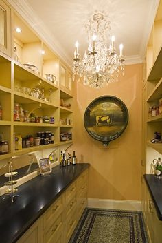 33 Kitchen Pantry Design Ideas:  I love this...but my husband would flip if I told him I wanted a chandelier in the pantry.  Would NEVER happen.