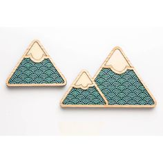 A stunning addition to our homewares collection, these mountains can either freestone or wall mount (we recommend using velcro wall stickers). With a Tasmanian oak frame, they feature a teal wave pattern that is sourced from a vintage Japanese painting from the 1800's. The large and small mountain are joined in a single piece with the middle mountain being separate. They come packaged in a cotton draw-string bag. Whats not to love?!