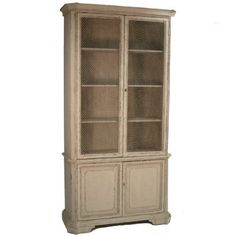 This stately bookcase or display cabinet has rustic, farmhouse appeal. This cabinet features solid pine constructed, chicken wire doors and a distressed neutral