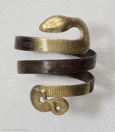 """Serpentine bracelet, discovered near Corinth, Greece, 4th-3rd centuries BC. """"Snakes, traditionally associated with the underworld, were a favorite motif in ancient Greek jewelry, possibly due to the widespread belief in their magic powers."""" -The Louvre"""