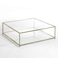 Metal frame with an aged brass finish.2 tempered glass tops, 8mm thick.Measurements:L100 x H33 x D100cm.