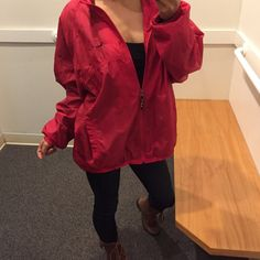 Rare vintage red Nike windbreaker Size large women's. Fits true. I love the oversized look I bought this for the Olympics this year so if it doesn't sell I'll keep it. Serious buyers only. No trades do not ask, firm price. Like brand new soft and windbreaker material double lined. 100% nylon body 100% polyester lining Nike Jackets & Coats