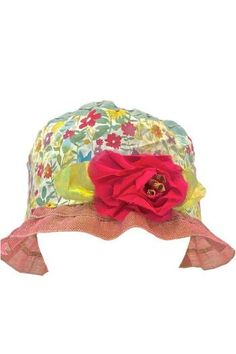 """Pretty and feminine sheer color block hat in colors light blue on crown with soft floral print band in colors fuchsia, turquoise and lime. Small fuchsia flower and silky leaves in color lime on band. Narrow brim at 1 3/4"""" wide in color pink. This dressy hat is size 56 Italian size which is 4 1/2 French size and 6 7/8 English size. It fits size small head perfectly and made for ladies with size small head. Made in Italy from Grevi."""