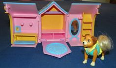 Polly Pocket Dog House. I had this one and a poodle one.