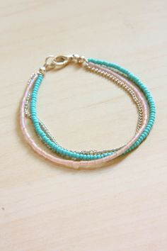 Summer Seed Bead Bracelet DIY Tutorial 2019 With three stands of seed beads bugle beads and chain this delicate and lightweight seed bead bracelet is perfect for summer! The post Summer Seed Bead Bracelet DIY Tutorial 2019 appeared first on Jewelry Diy. Seed Bead Bracelets Diy, Beaded Bracelets Tutorial, Beaded Bracelet Patterns, Silver Bracelets, Beading Patterns, Handmade Bracelets, Colorful Bracelets, Silver Jewelry, Jewelry Bracelets