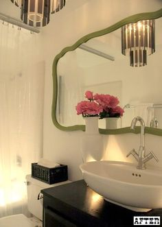 Bathroom: I adore the green mirror.