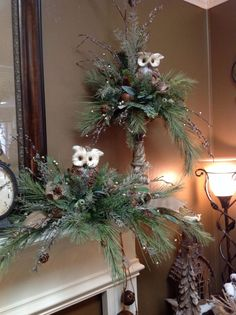 Love the owls in greenery, for the mantel, adore the one a top the candle stick, the burlap ribbon make these perfect with many different decor styles