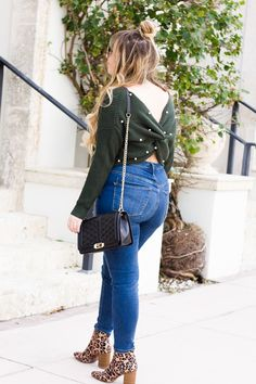 Twist back sweater and jeans