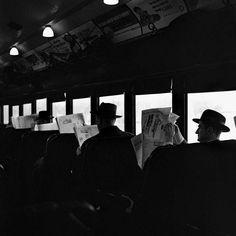 Men reading papers on train - 1950 - photographer Vivian Maier.