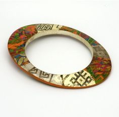 Bangle | Nathalie Rolland-Huckel.  Lacquer on wood