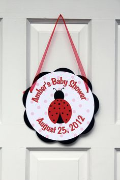 Ladybug Baby Shower Sign -  Door Hanger -  Ladybug Baby Shower Decorations in Red and Black. $9.00, via Etsy.