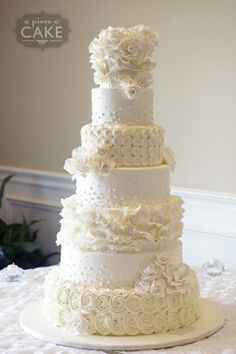 Beautiful 6-tier wedding cake with lovely textures!