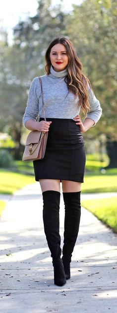 The cutest outfit! / Fashion blogger Mash Elle shares an easy and affordable outfit! She styles a turtleneck sweater dress with a black mini skirt, over the knee boots and a waterfall cardigan. You'll want to copy this look! #winterstyle #fashionblogger #sweaterdress #miniskirt #overthekneeboots