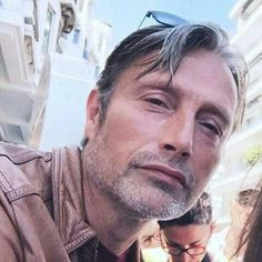 Mads wearing glasses on the top of his head