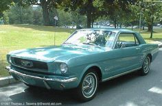 My first car!  1966 Turquoise Mustang Coupe ~ mine had black interior.  My parents paid $600 for it.  Wish I had it now!