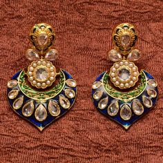 Anvi's elegant blue enamel work and meenakari earrings with uncut stones