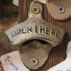 ONE (1) Bronze Hand Painted Open Here Cast Iron Wall Mount Bottle Opener - Twenty-two Colors Available. Measures 3 long, 2.5 wide, 1.5 deep. Two