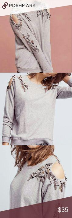 Anthropologie Twilight Ivy Pullover by Deletta Cotton.  Embellished shoulder detail.  Assymetrical shoulder cutouts. Pullover styling.  Hand wash. The contrast of the delicate beading and simple gray crew neck sweatshirt makes for a relaxed chic look. Some loose beading (received that way upon purchase) and one or two missing which isn't noticeable.  Close up pic shows discrete white dots; I'm assuming it was a guide to where the beads were be sewn.  Worn once. Anthropologie Tops Blouses