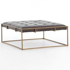 "Chic style meets inviting comfort with the Linton coffee table. A blind-tufted, top-grain leather cushion in Ebony upholstery floats effortlessly on an antique brass base with cage-like detailing. Available in Small, Large, and Square; Top-grain leather cushion; Small: 50""W x 32""D x 16.25""H; Large: 63""W x 35.5""D x 16.25""H; Square: 36""W x 36""D x 16.25""H"