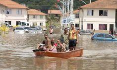 JORNAL O RESUMO: Casas alagadas em condomínio após forte chuva em M...