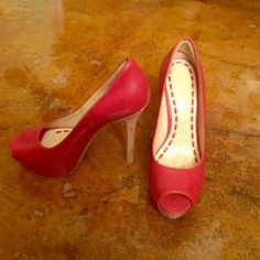 Enzo Angiolini Red Heels Red open toe leather heels with cork heel.  Purchased from Nordstrom's.  Very comfortable because of the platform.  Hardly worn.  Size 6.  Sophisticated and fun. Enzo Angiolini Shoes Heels