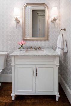 Vanity in keeping with the decor of the bathroom with gray wallpaper by Thibaut. Martha O'Hara Interiors. #bathroomvanities Worlds Away mirror sconces
