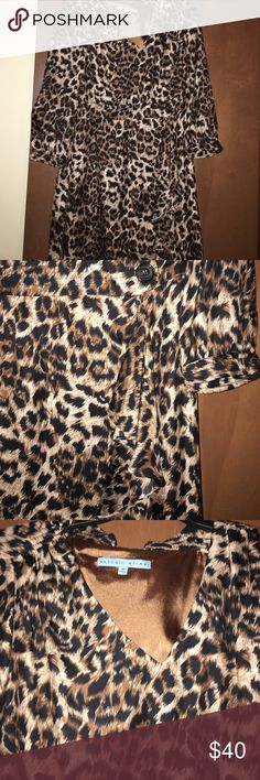 """Antonio Melani cheetah dress Silk like material. V neck. 3/4 sleeve. Dress is fully lined. Has a ruffle going down the left side, down from a black button. Worn only once. Hidden zipper on under left arm. optic. 37"""" length from shoulder to hem ANTONIO MELANI Dresses"""
