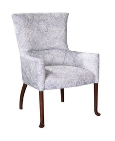Eloise Wing Chair Eloise is based off of a stunning antique in Mariette's New York office that she obtained at an Olympia Fair in London. Eloise has been resized keeping the elegant details of the tapering cylindrical leg capped with a carved puck-shaped foot and the graceful arc of the back legs.