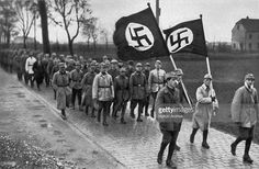 1923. Members of the SA, the paramilitary wing of the Nazi party, during a training march outside Munich.