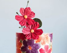 How to make a cake wrapped in chocolate, with a hand-painted floral pattern. A great cake project for birthdays, showers, Valentines Day and Mothers Day.