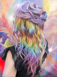30 Amazing Rainbow Curly Hairstyles for Long Hair in 2018. We assure you that after visiting this you'll really obsessed by our stunning rainbow hair color ideas that we have specially gathered up for you to sport in year 2018. Discover awesome ideas about rainbow hair colors that are most famous trends nowadays among ladies of various age groups. You may use this beautiful hair color for you soft curls in 2018.