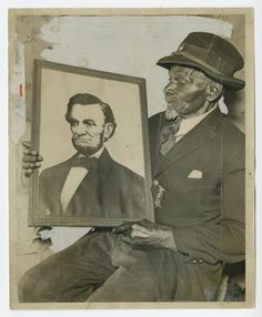 James Brown, Civil War veteran, with a picture of Abraham Lincoln,  Collection of the Smithsonian National Museum of African American History and Culture, Gift from the Liljenquist Family Collection.