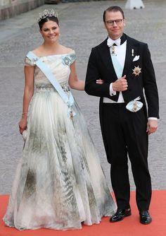 Prince Carl Philip's eldest sister, Crown Princess Victoria of Sweden, and her husband Prince Daniel of Sweden smile for the camera