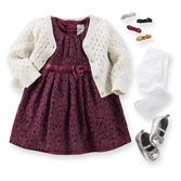 Glitter hair clips and sparkle shoes make this classic red lace dress extra fun. Add tights and cardigan for a picture-perfect look.